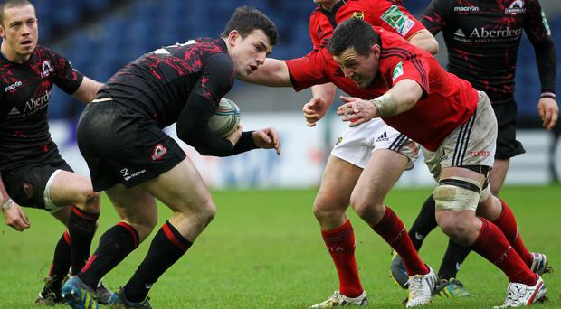 Hooker Damien Varley, pictured making a tackle for Munster against Edinburgh in the Heineken Cup, has been forced to retire from a foot injury after winning three Ireland caps