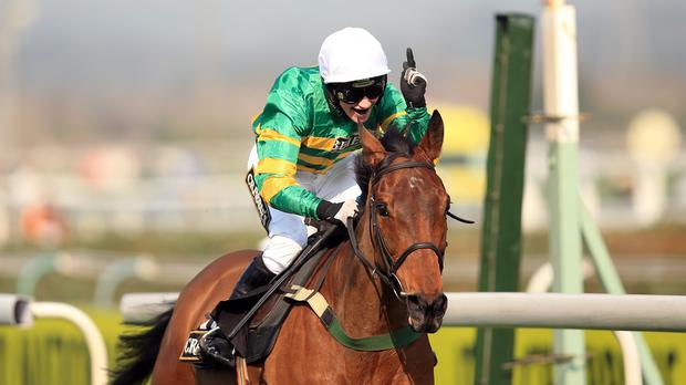 Nina Carberry celebrates partnering On The Fringe to victory in the Crabbie's Fox Hunters' Chase at Aintree