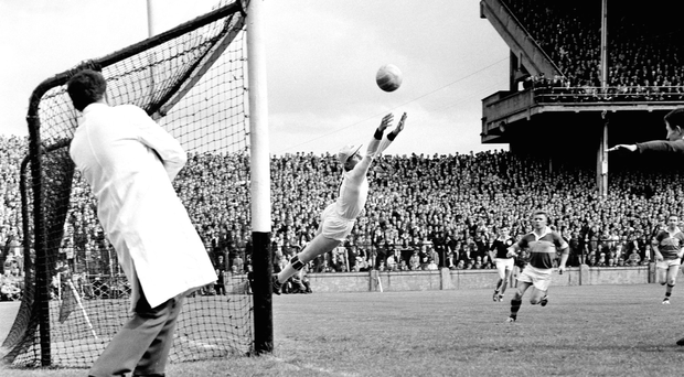 Galway goalkeeper Johnny Geraghty ensures the ball goes wide during his side's victory over Kerry in the 1965 NFL final