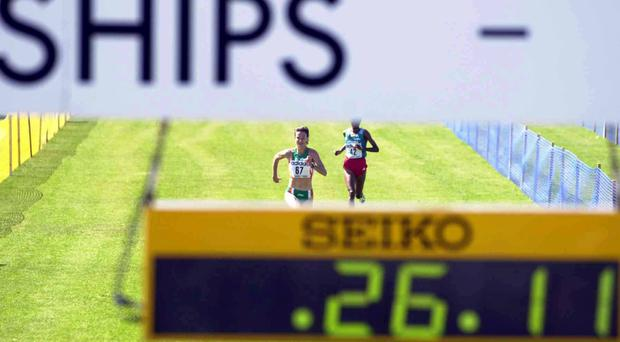 Ireland's Sonia O'Sullivan (67) comes down the finishing straight ahead of Ethiopia's Merima Denboba (42) during the Women's Long Race (8080m). World Cross Country Athletics Championship