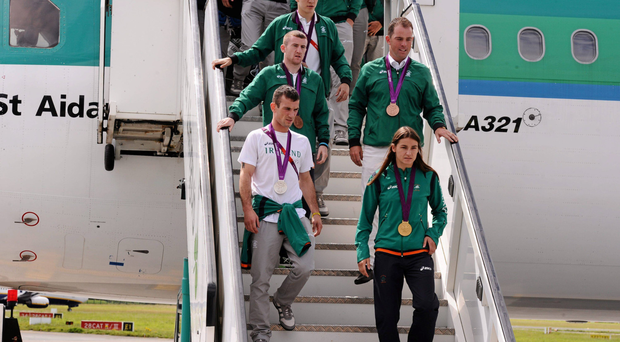 Katie Taylor (left) leads Ireland's Olympic medallists down the steps of their flight back from London 2012