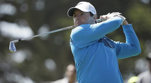 Rory McIlroy, pictured, defeated Jason Dufner 5&4 (AP)