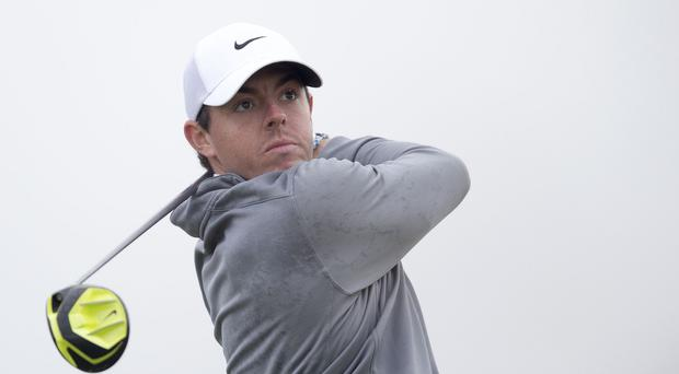 Rory McIlroy, pictured, must return tomorrow to face Paul Casey
