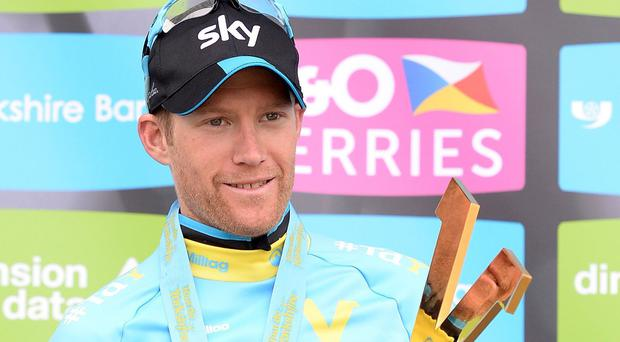 Team Sky Rider Lars-Petter Nordhaug celebrates with the trophy after the Tour de Yorkshire.