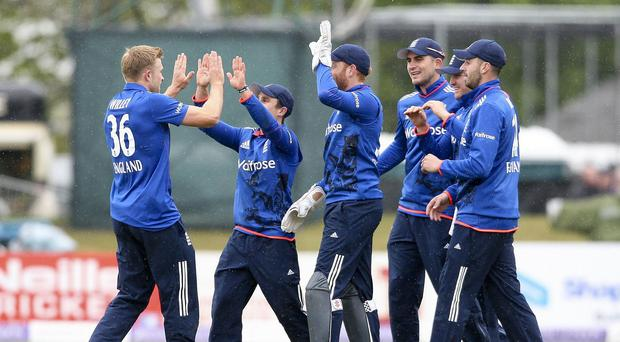 Captain James Taylor congratulates David Willey on his maiden international wicket in Dublin