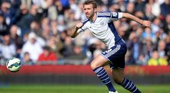 Gareth McAuley has agreed to stay at West Brom for another year