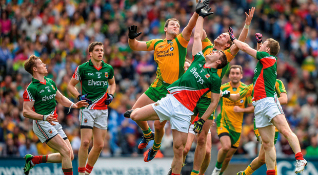 Clash of the giants: Action from the 2013 All-Ireland quarter-final between Mayo and Donegal, with Mayo's Séamus O'Shea reaching for the high ball against Michael Murphy and Neil Gallagher RAY McMANUS / SPORTSFILE