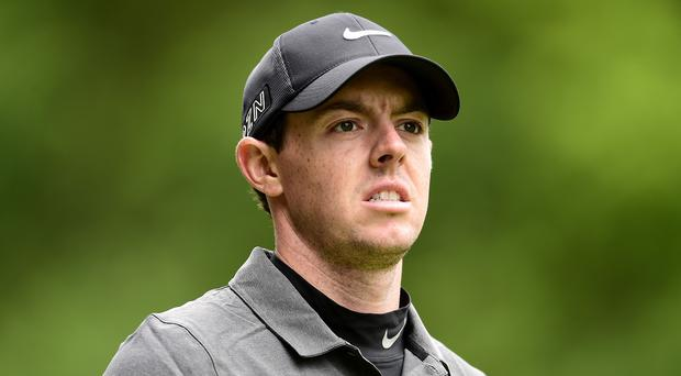 World number one Rory McIlroy has suffered ankle ligament damage playing football