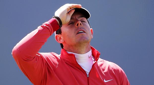 Rory McIlroy is out of The Open after injuring his ankle playing football