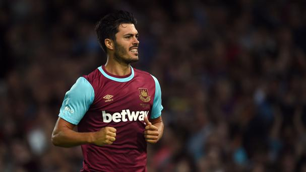 James Tomkins celebrates his winning goal for West Ham