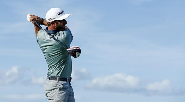 Dustin Johnson claimed a one-shot lead after a windswept Saturday at St Andrews