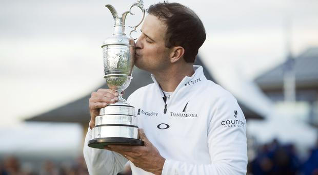 Zach Johnson kisses the Claret Jug after winning the Open