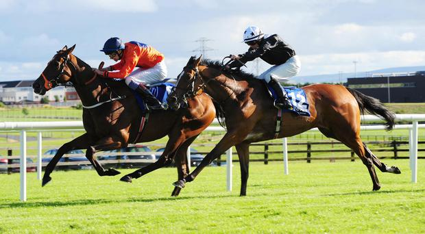 Hint Of A Tint (right) comes to pass Baraweez to win the Topaz Mile at Galway