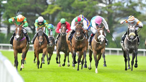 Laviniad ridden by Declan McDonagh (left) beats Tested (second right) in the Corrib Fillies' Stakes