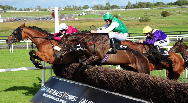 Rogue Angel jumps the last just in front in the Galway Blazers