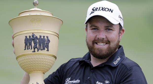 Shane Lowry lifts the trophy in Akron (AP)