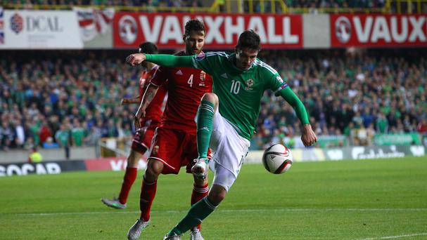 Kyle Lafferty, pictured right, was the hero for Northern Ireland