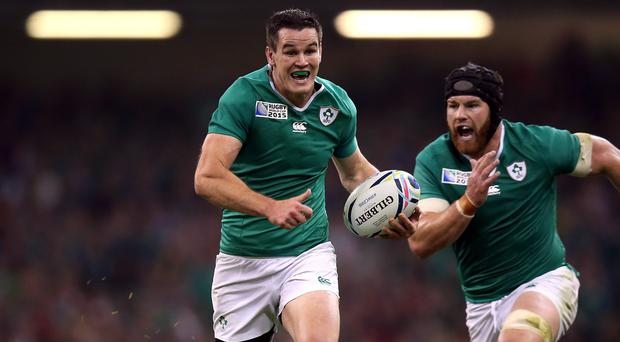 Ireland's Johnny Sexton races clear to score his side's third try against Canada