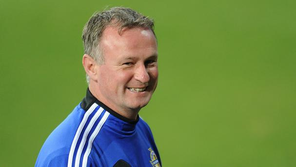 Northern Ireland manager Michael O'Neill has set a tongue-in-cheek curfew should his side beat Greece on Thursday