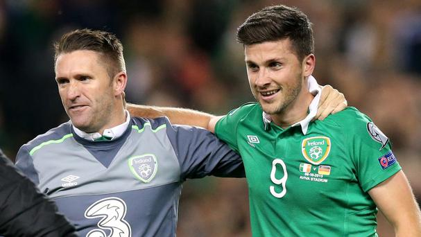 Republic of Ireland skipper Robbie Keane, left, congratulates match-winner Shane Long