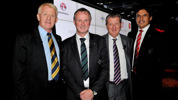 Michael O'Neill, second left, is hoping to glean some tournament tips from Roy Hodgson, second right