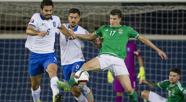 Paddy McNair, right, suffered an abdominal injury while on international duty