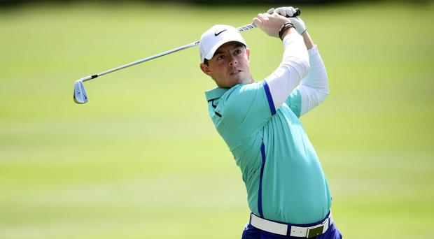 Rory McIlroy, pictured, remained in pursuit of leaders Victor Dubuisson and Jaco van Zyl in Turkey