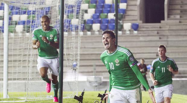 Northern Ireland's Kyle Lafferty (centre) helped secure qualification for the Euro 2016 finals.