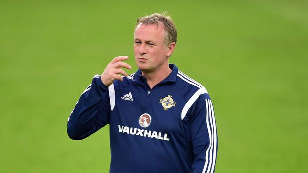 Michael O'Neill is already thinking about the composition of his 23-man squad for Euro 2016