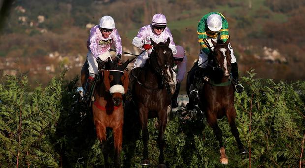 Josies Orders ridden by Nina Carberry, right, jumps en route to victory
