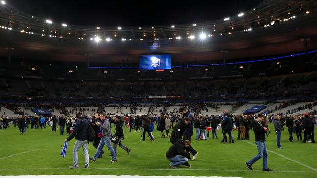 Fans took to the Stade de France pitch, where France played Germany, after the terrorist attacks in Paris