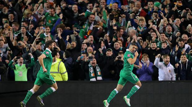 Jonathan Walters, right, celebrates after opening the scoring for Martin O'Neil's men