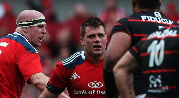 CJ Stander, centre, has signed a two-year contract extension at Munster