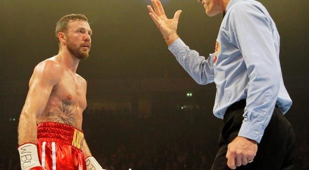 Andy Lee faces the count from the referee after being knocked down during last night's fight Photo: PA