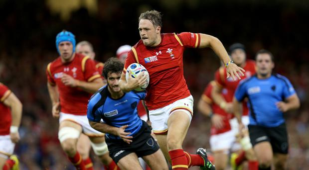 Cory Allen, pictured with the ball on Wales duty, suffered an injury when playing for Cardiff Blues
