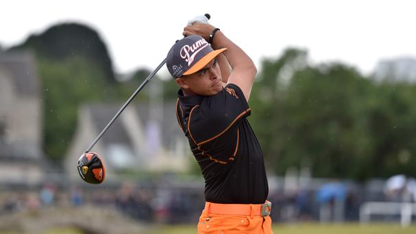 Rickie Fowler set the halfway target in the Honda Classic on Friday