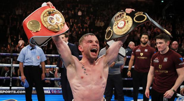 Carl Frampton celebrates beating Scott Quigg in Manchester