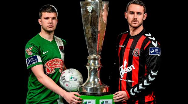 Danny Morrissey, left, Cork City, and Kurtis Byrne, Bohemians with the league trophy Photo: Sportsfile
