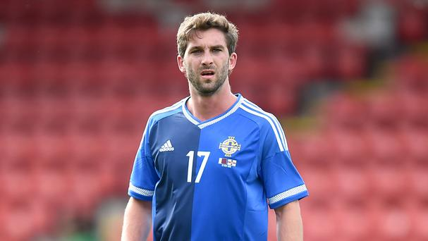 Will Grigg will stay with Wigan rather than joining up with Northern Ireland this week