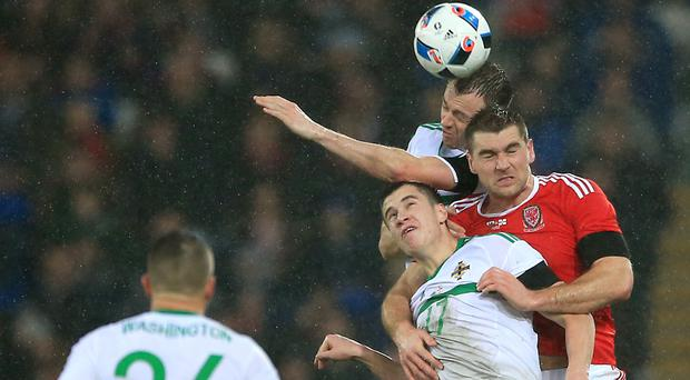 Paddy McNair, front, and Sam Vokes, right, were under scrutiny in Cardiff
