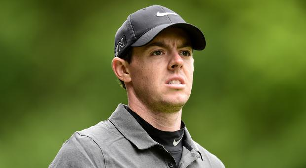 Defending champion Rory McIlroy is through to the semi-finals of the WGC-Dell Match Play