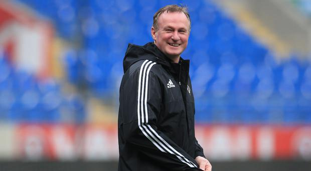 Michael O'Neill will watch Germany play Italy in Munich on Tuesday
