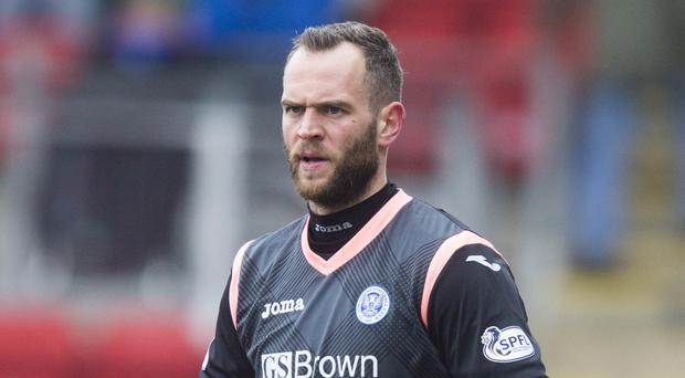 St Johnstone goalkeeper Alan Mannus would love to go to Euro 2016 with Northern Ireland but is remaining cautious