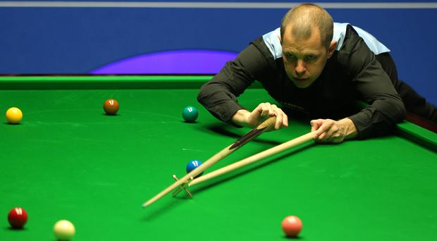 Barry Hawkins will take a 5-3 advantage into Sunday afternoon's resumption