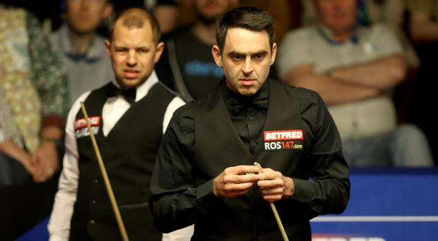 Barry Hawkins, left, leads Ronnie O'Sullivan, right, at the Crucible