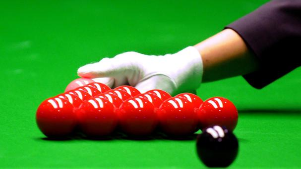 The man put snooker balls in a sock