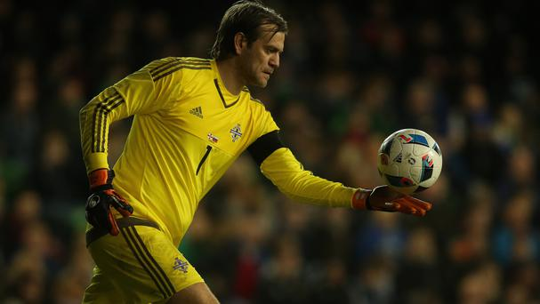 Northern Ireland goalkeeper Roy Carroll is returning home to play for Linfield