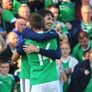 Kyle Lafferty, right, celebrates after scoring early on