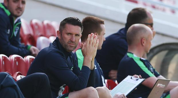 Republic of Ireland skipper Robbie Keane sits in the stands during a training session at Turner's Cross, Cork