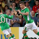 Stephen Ward, right, netted in the second half to reduce the deficit